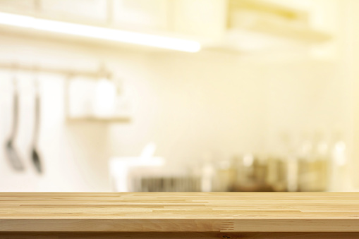 wood table top on blur kitchen interior background stock
