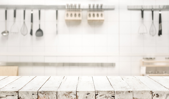 wood table top on blur kitchen room background stock photo