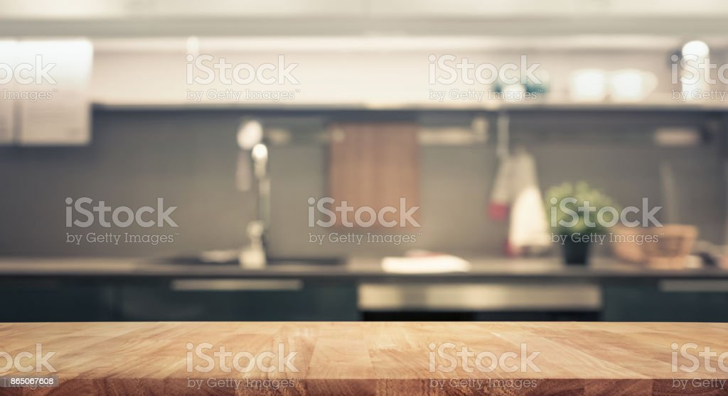 Wood table top on blur kitchen wall room background stock photo