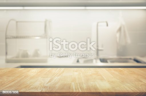 923629650 istock photo Wood table top on blur kitchen wall room background 865067656