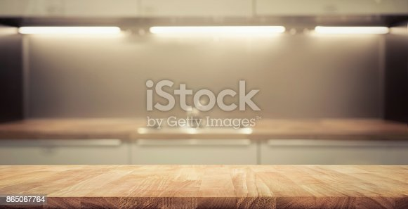 923629650 istock photo Wood table top on blur kitchen wall room background 865067764