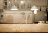 Wood table top on blur kitchen wall room background