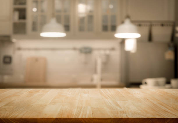 wood table top on blur kitchen wall room background - kitchen imagens e fotografias de stock