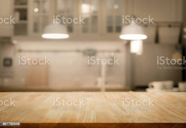Wood table top on blur kitchen room background .For montage product display or design key visual layout.Wood table top on blur kitchen room background .For montage product display or design key visual layout.