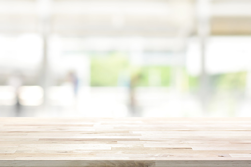 Wood Table Top On Blur Kitchen Window Background Stock ...
