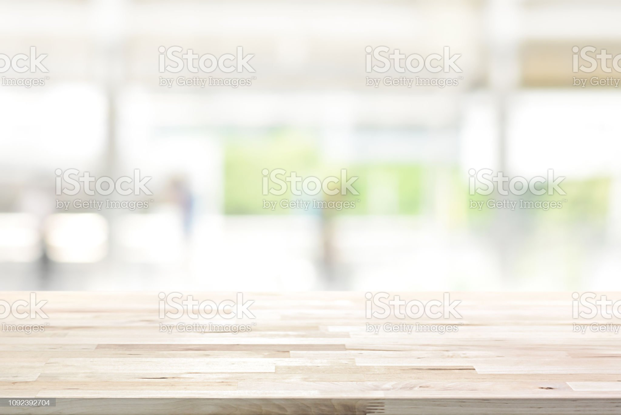 ✓ Wood table top on blur kitchen window background Stock Photos