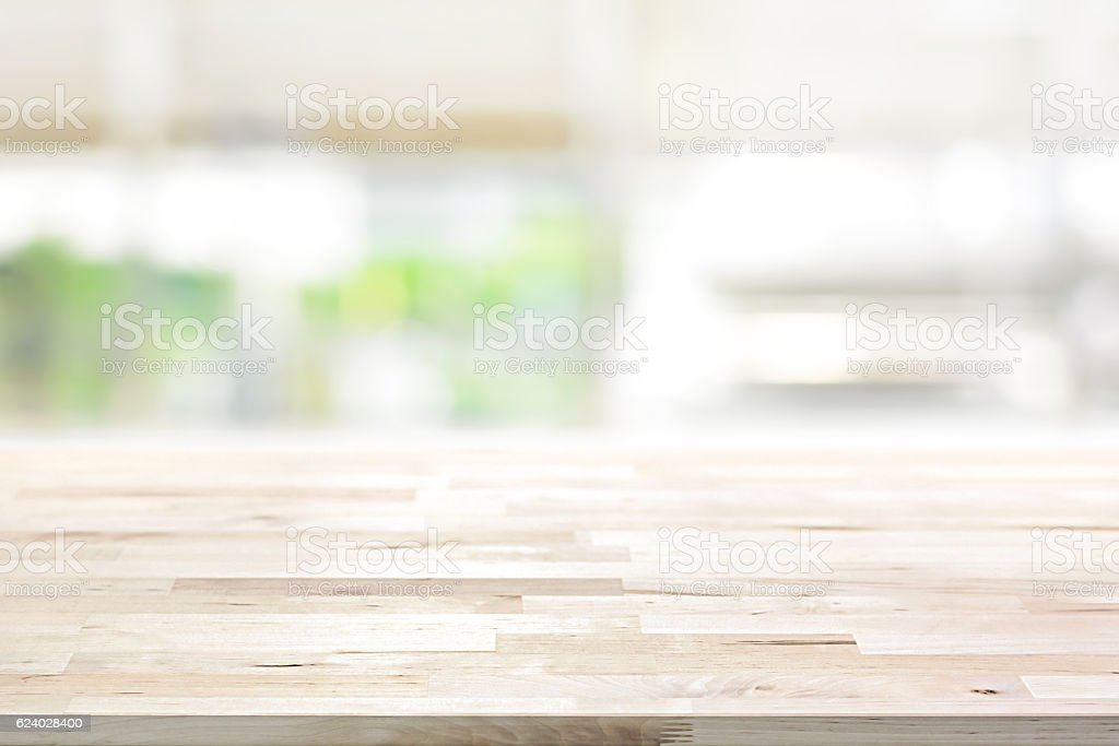 Wood table top on blur kitchen window background bildbanksfoto