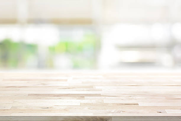 wood table top on blur kitchen window background - kitchen counter stock photos and pictures