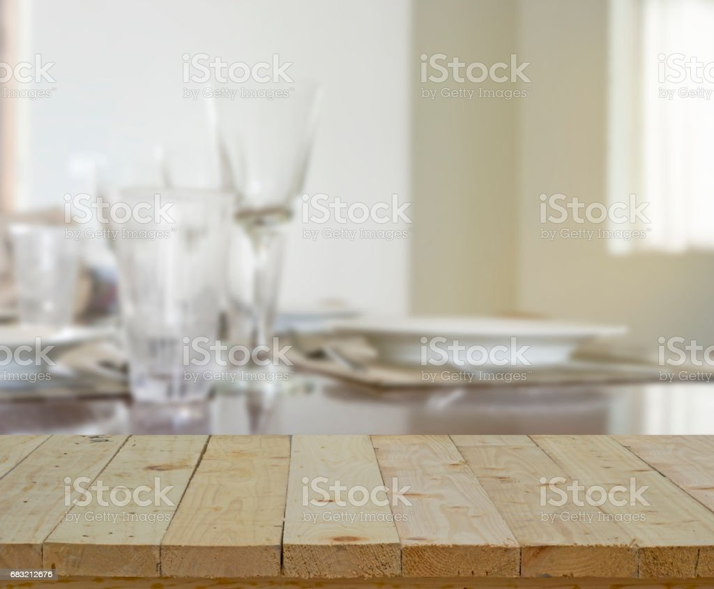 wood table top on blur of glass and dinner table royalty-free stock photo