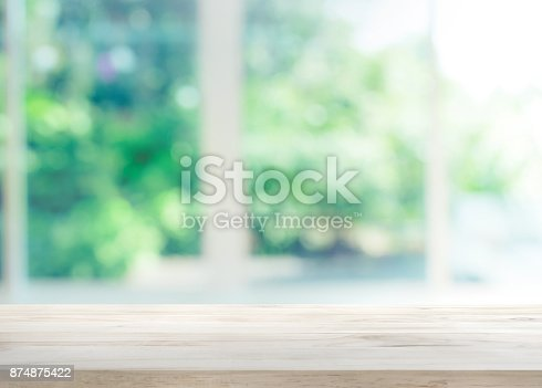 885452818istockphoto Wood table top on blur of window with garden flower 874875422