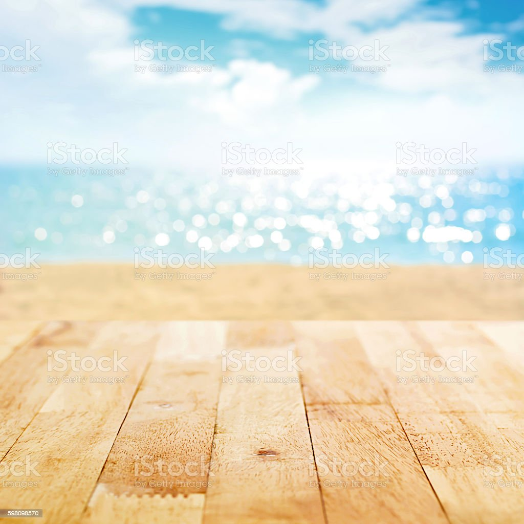 Wood Table Top On Blur Summer Beach Background Royalty Free Stock Photo