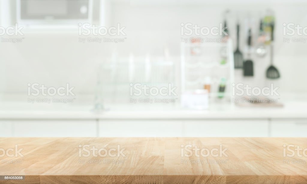 Wood table top on blur white kitchen wall room stock photo