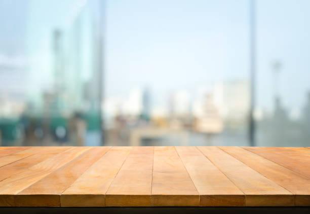 Wood table top on blur window glasswall background with city viewfor picture id1145489346?b=1&k=6&m=1145489346&s=612x612&w=0&h=eiqqn7xbanatxaac59ldidpfcwgdde 7jreai w6wfa=