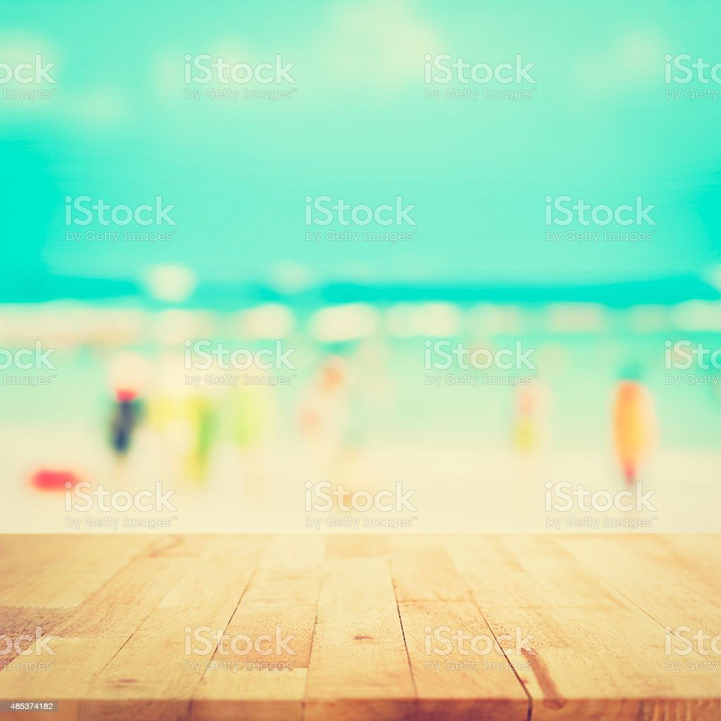 Wood Table Top On Blurred Beach Background Vintage Tone