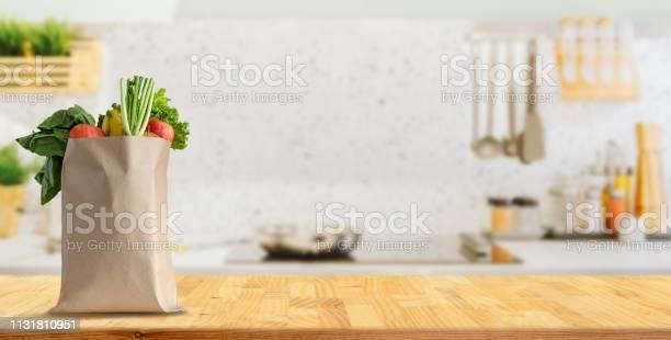Wood table top on blurred kitchen background picture id1131810951?b=1&k=6&m=1131810951&s=612x612&h=qxdnmevvs7t1aj kzjmedhxvx3ji4wa c2bq ctbcxe=