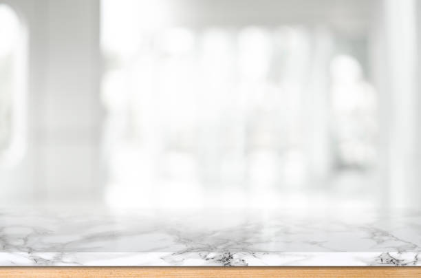 Wood table top on blurred kitchen background Wood table top on blurred kitchen background kitchen counter stock pictures, royalty-free photos & images
