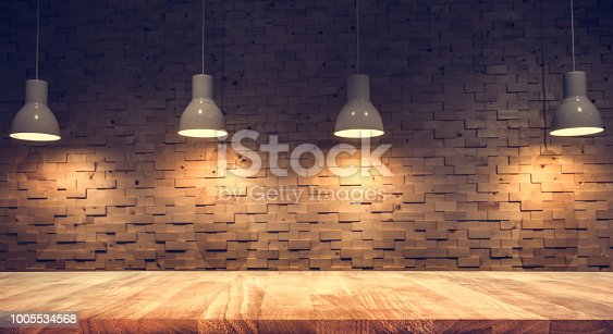 924418708 istock photo Wood table top on blurred of counter cafe shop with light bulb background.For montage product display or design key visual 1005534568