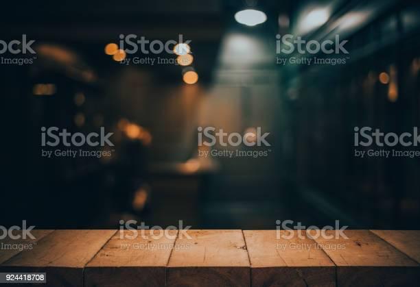 Wood table top on blurred of counter cafe shop with light for or picture id924418708?b=1&k=6&m=924418708&s=612x612&h=mru0g0urp dm4ukb6h4szhp3qmiw745lbxid0 vdjp0=