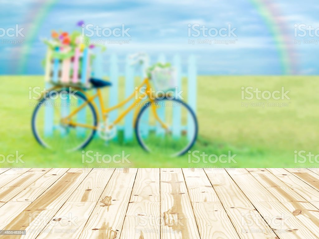 Wood table top on blurry Bike in beautiful nature background stock photo