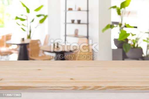 istock Wood table top on defocused restaurant or coffee shop background 1139672363