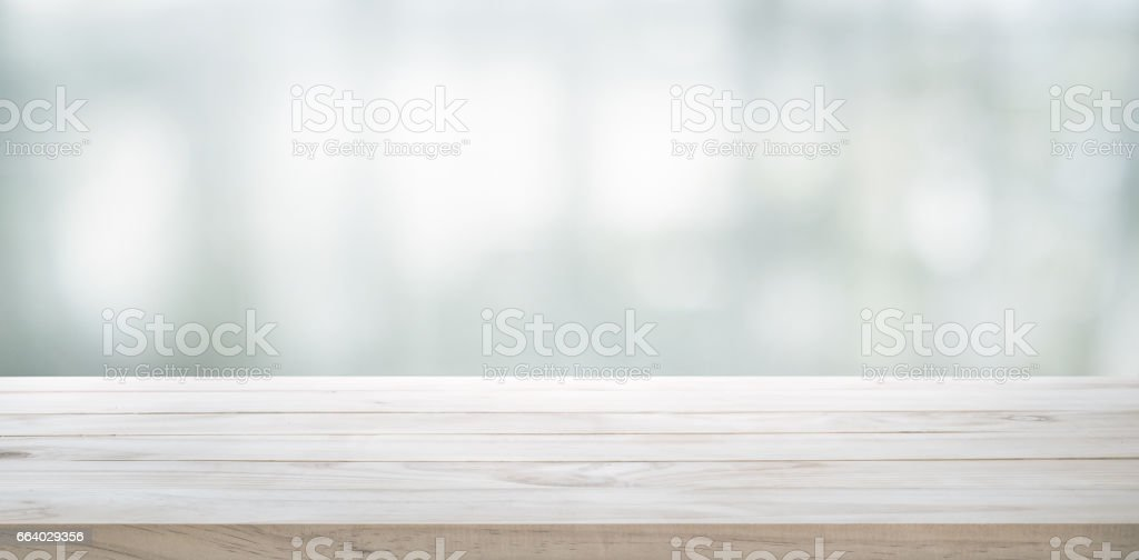 Wood table top on glass wall abstract background. - foto stock