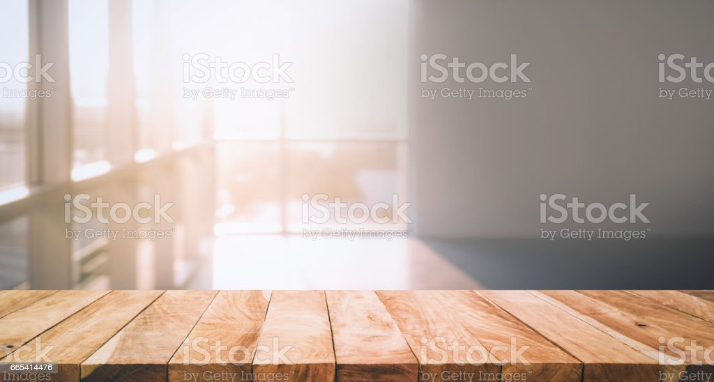 Wood table top on glass wall abstract background. stock photo