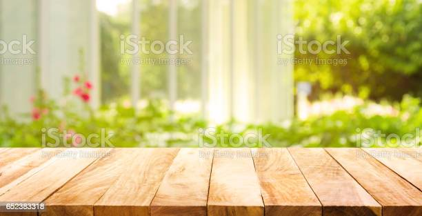 Wood table top on green from garden in morning background picture id652383318?b=1&k=6&m=652383318&s=612x612&h=akxin6o5w7nwloas0tuogkhsuaysbfjhnwbua138d i=
