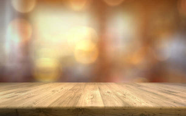 wood table top on light blur background empty brown wood table - table foto e immagini stock