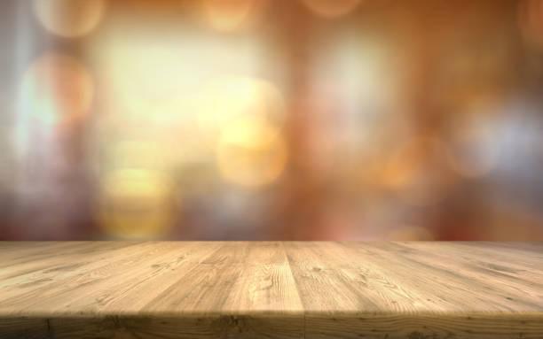 明るいぼかしの背景に木製のテーブルトップ空の茶色の木のテーブル - テーブル 無人 ストックフォトと画像