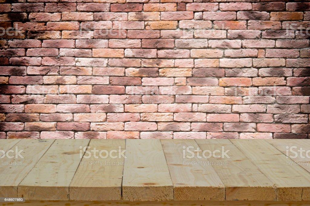 wood table top on retro brick wall texture stock photo