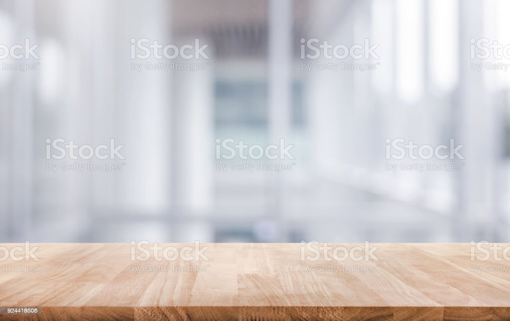 Wood table top on white abstract background form office building. - Стоковые фото Абстрактный роялти-фри