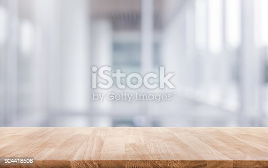 istock Wood table top on white abstract background form office building. 924418506