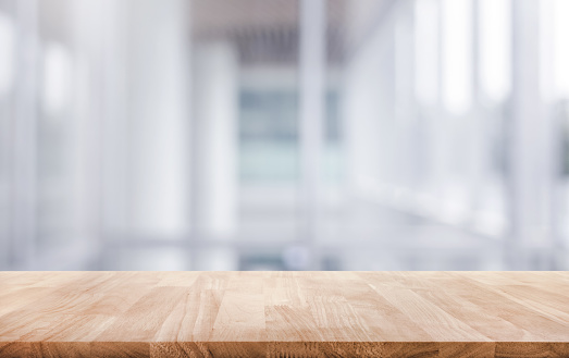 Wood table top on white abstract background form office building.For montage product display or design key visual layout