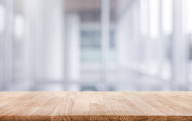 Wood table top on white abstract background form office building. stock photo