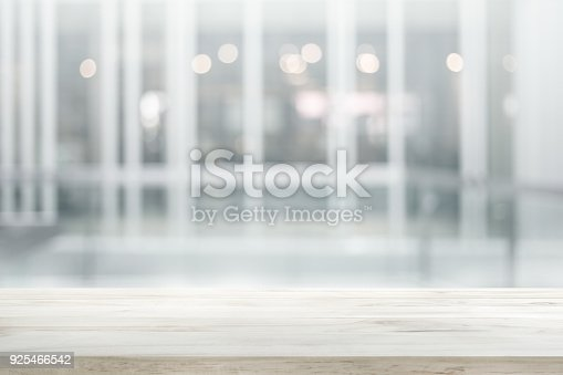 istock Wood table top on white abstract background form office building 925466542