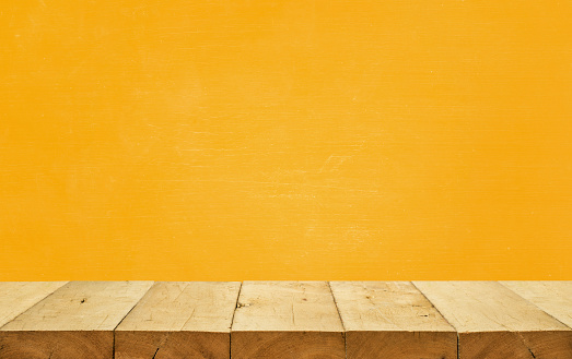 Empty wood table top on yellow color background.For montage product display or design key visual layout