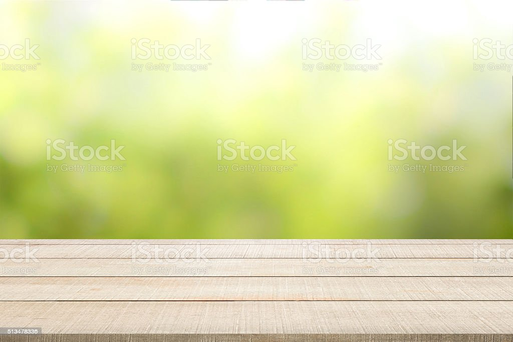 wood table top panel on green background stock photo
