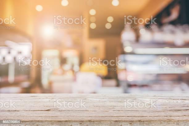 Wood table top with abstract blur coffee shop background picture id855256854?b=1&k=6&m=855256854&s=612x612&h=wystxdbsopvjyixc3zxjyozlnod9ebnn5m rdsxovuu=
