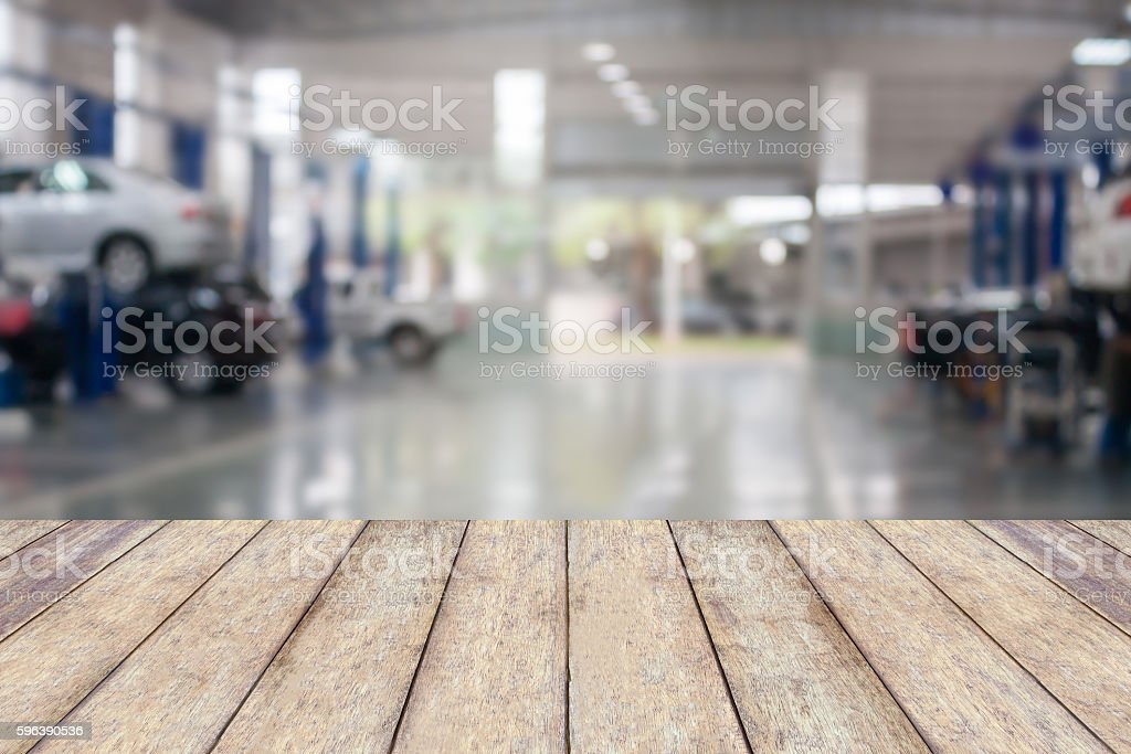 Wood table top with blur garage background stock photo