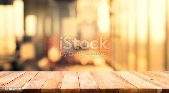 924418708 istock photo Wood table top (Bar) with blur light bokeh in dark night cafe,restaurant 1154539666