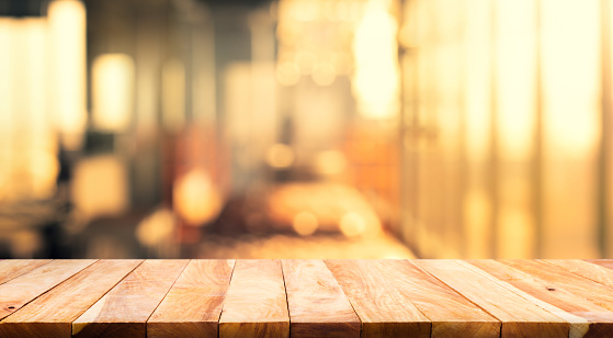593305530 istock photo Wood table top (Bar) with blur light bokeh in dark night cafe,restaurant 1154539666