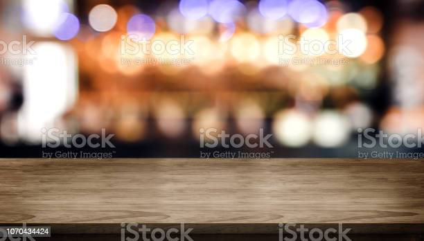 Wood table top with blur nightclub bar counter with bokeh light mock picture id1070434424?b=1&k=6&m=1070434424&s=612x612&h=fgii2ychswukilevptmgbh3nzybxu6h7t5jopooacm0=