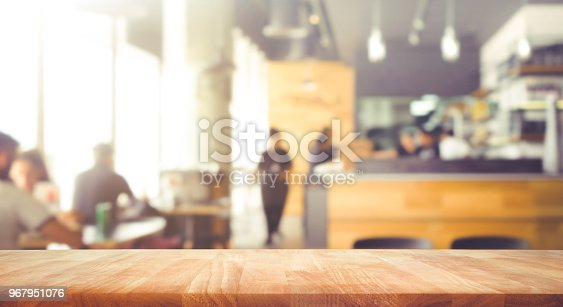 Wood table top with blur of people in coffee shop or (cafe,restaurant )background.For montage product display or design key visual layout