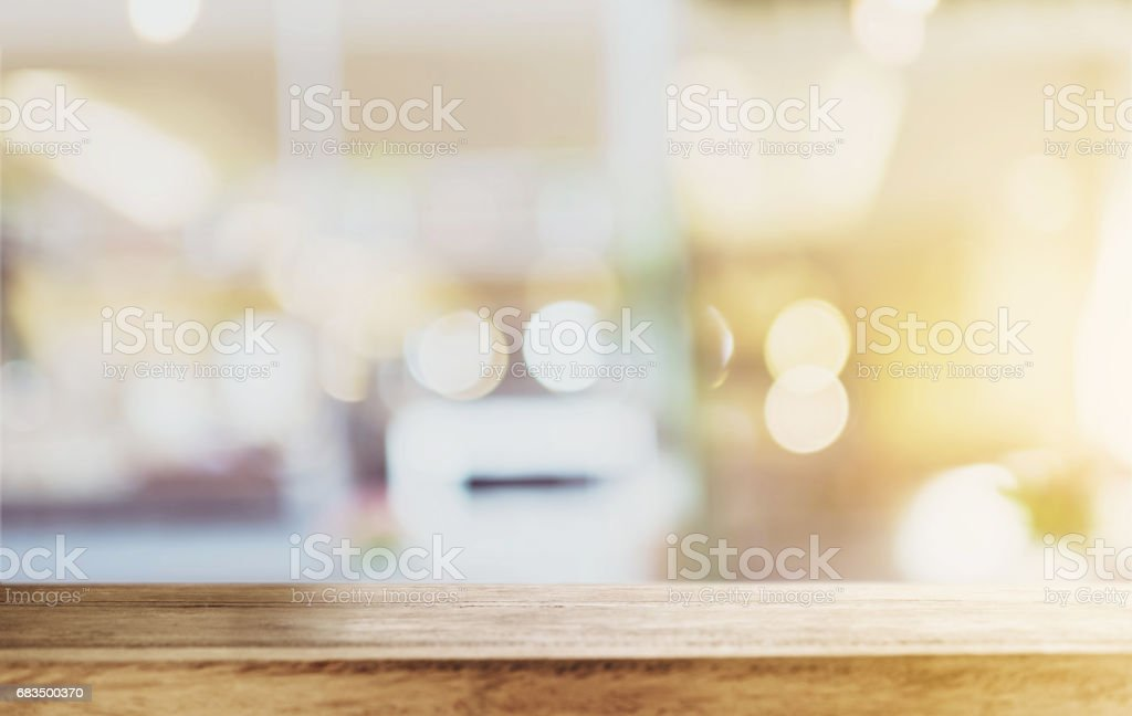 Wood table top with blurred defocus backgrounds stock photo