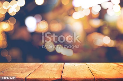 Empty of wood  table top with  blurred light gold bokeh abstract background.For montage product display or design key visual layoutEmpty of wood  table top with  blurred light gold bokeh abstract background.For montage product display or design key visual layout