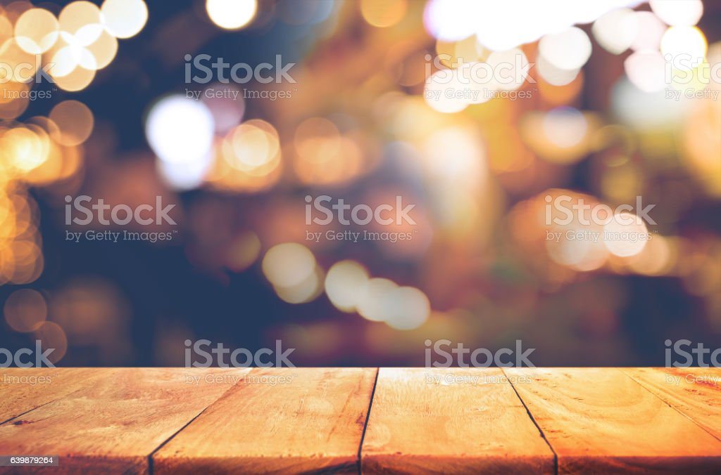 Wood  table top with  blurred light gold bokeh abstract background stock photo