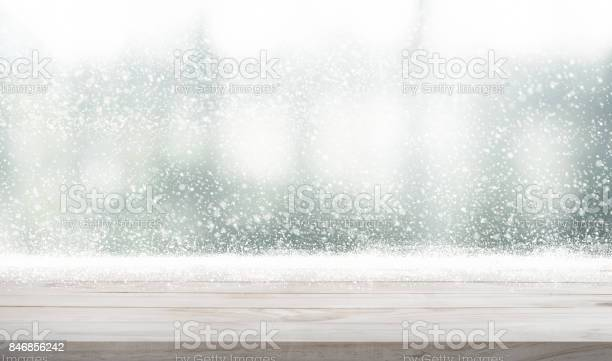 Wood table top with snowfall of winter season background picture id846856242?b=1&k=6&m=846856242&s=612x612&h=bgswyvfl7kraznmdyve8ljo58jawvzbjzcbndy44sfq=