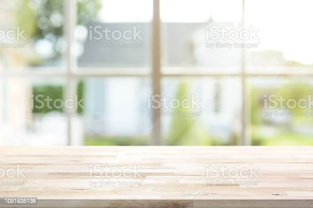 Wood table top with window and morning sunlight in background picture id1051635138?b=1&k=6&m=1051635138&s=612x612&h=aqiqntrjpx3lyhwtx vqx7hzkr daxrlewmsahiwmxm=