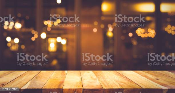 Wood table with blur light bokeh in dark night cafe picture id879637826?b=1&k=6&m=879637826&s=612x612&h=kwztzpbx4wofajr4 acngmdebtkr3o9d04jzdumaws4=
