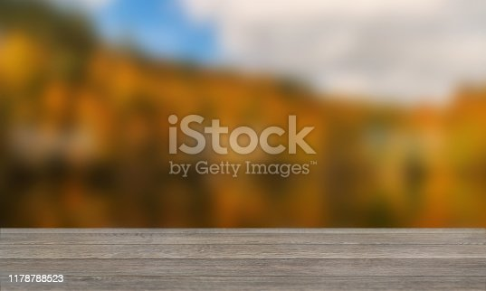 989111446istockphoto Wood Table with Blurred Nature Background 1178788523